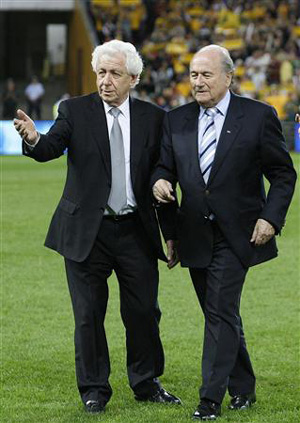 Photograph of Frank Lowy and Sepp Blatter on football pitch in Sydney